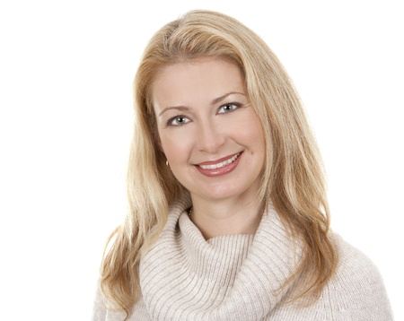 pretty blond woman wearing beige sweather on white background