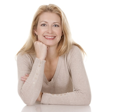 pretty blond woman wearing beige top sitting on white background Stock Photo - 15814933