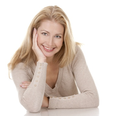 pretty blond woman wearing beige top sitting on white background Stock Photo - 15814939