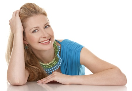 classy blond woman in her 40s wearing turquois dress photo