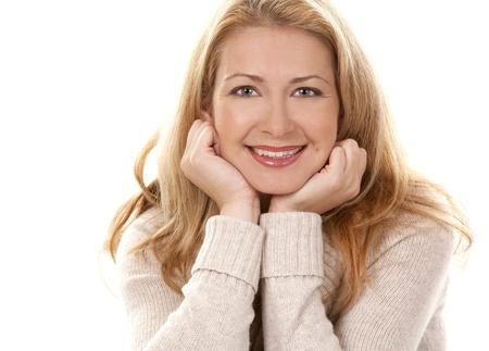 winter woman: pretty blond woman wearing beige sweather on white background