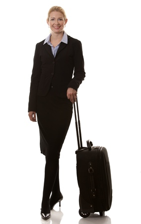 business woman in her 40s with suitcase on white background Stock Photo - 15921142