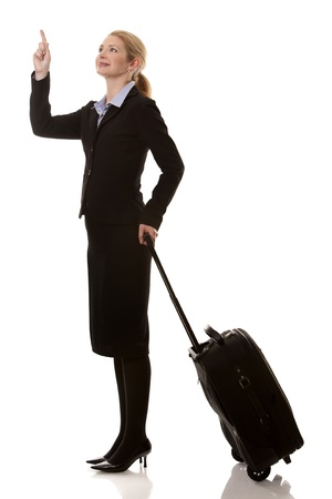 business woman in her 40s with suitcase on white background photo