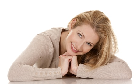 pretty blond woman wearing beige top sitting on white background Stock Photo - 15921162