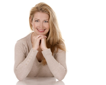 pretty blond woman wearing beige top sitting on white background Stock Photo - 15921148