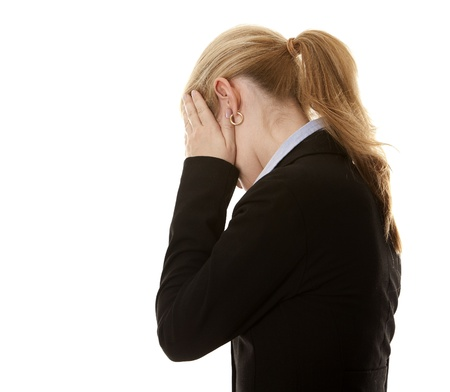 blond business woman hiding her face on white background