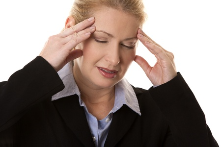 blond business woman having a headache on white background photo