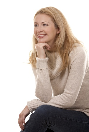 pretty blond woman wearing beige sweather on white background Stock Photo - 16302389
