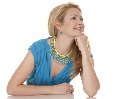 classy blond woman in her 40s wearing turquois dress Stock Photo - 16302343