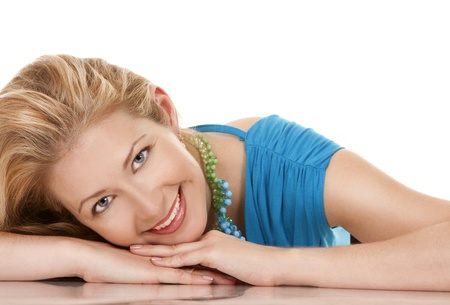 classy blond woman in her 40s wearing turquois dress Stock Photo - 16302350