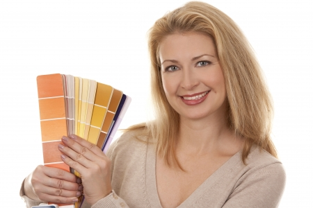 pretty blond woman holding color chart on white isolated background