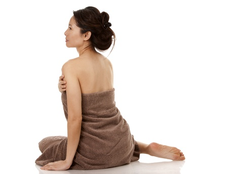 beautiful asian brunette wearing brown towel on white background Stock Photo - 16374411