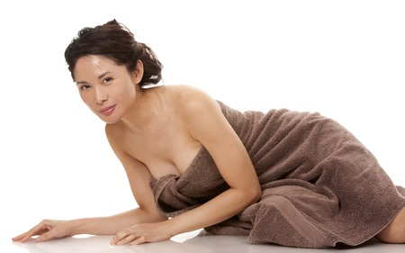 beautiful asian brunette wearing brown towel on white background Stock Photo - 16374427