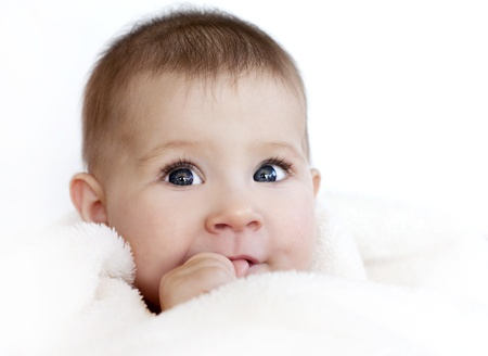 baby girl is wrapped in white blanket Stock Photo - 16374415