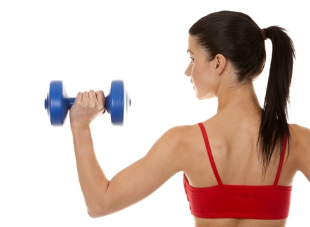 athletic brunette lifting weights on white isolated background photo