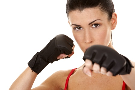 athletic brunette wearing boxing gloves on white isolated background photo