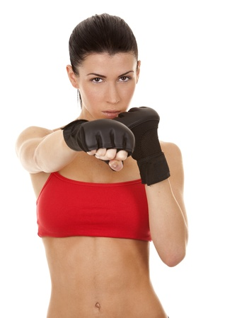 self expression: athletic brunette wearing boxing gloves on white isolated background