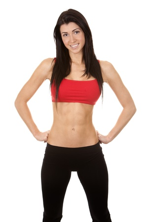 brunette wearing red and black fitness outfit on white background