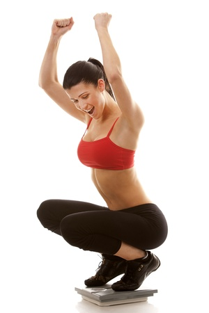 active brunette using scale on white isolated background