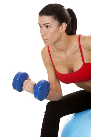 dumbells: athletic brunette lifting weights on white isolated background