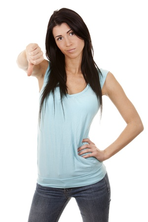 casual brunette showing thumb down gesture on white background Stock Photo - 16560069