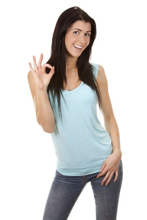 casual brunette showing ok gesture on white background Stock Photo - 16560072