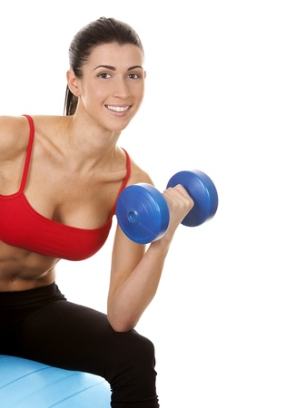 athletic brunette lifting weights on white isolated background