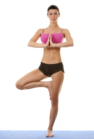 active brunette in yoga position on white isolated background Stock Photo - 16559997