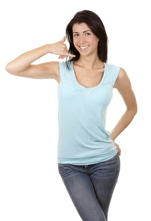 casual brunette showing call me gesture on white background Stock Photo - 16656746