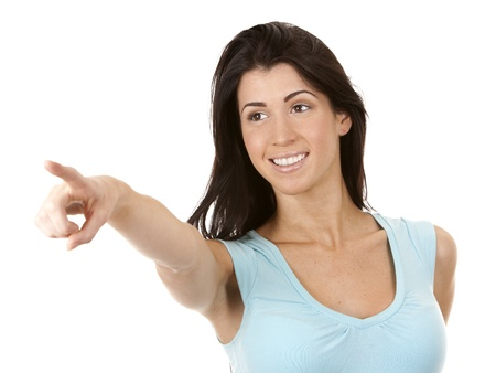 casual brunette pointing with her hand on white background Stock Photo - 16656739