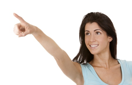 casual brunette pointing with her hand on white background Stock Photo - 16684438
