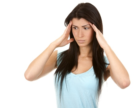 brunette having a headache on white isolated background Stock Photo - 16684431