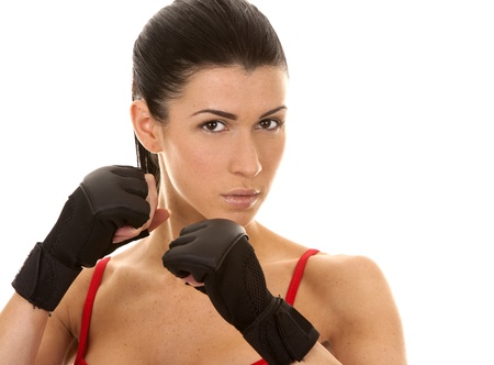 athletic brunette wearing boxing gloves on white isolated background Stock Photo - 16684437