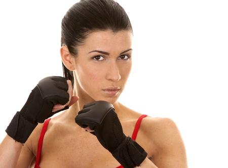 athletic brunette wearing boxing gloves on white isolated background Stock Photo - 16684437
