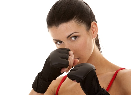 athletic brunette wearing boxing gloves on white isolated background Stock Photo - 16684439