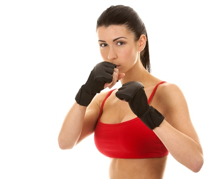 athletic brunette wearing boxing gloves on white isolated background Stock Photo - 16684440
