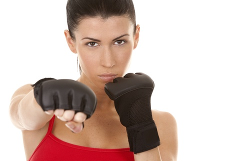 athletic brunette wearing boxing gloves on white isolated background Stock Photo - 16684436