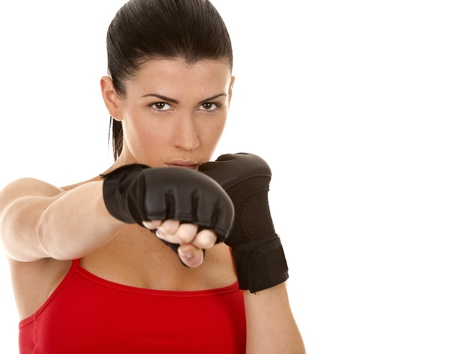 athletic brunette wearing boxing gloves on white isolated background Stock Photo - 16684432