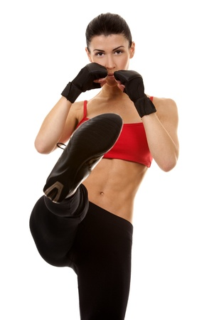 athletic brunette wearing boxing gloves on white isolated background Stock Photo - 16684427