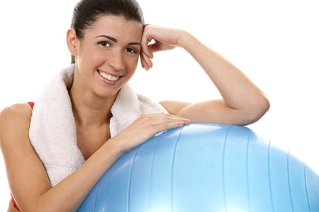 active brunette in red posing with exercise ball on white background Stock Photo - 16757024