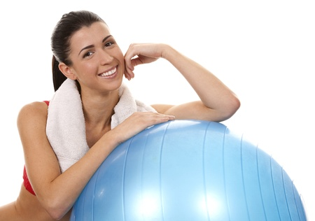 active brunette in red posing with exercise ball on white background Stock Photo - 16757019