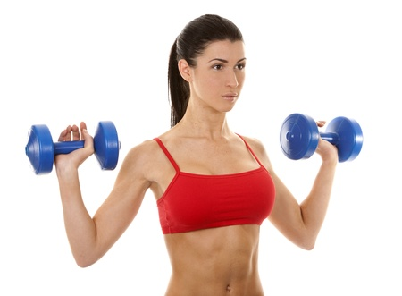 athletic brunette lifting weights on white isolated background Stock Photo - 16757020