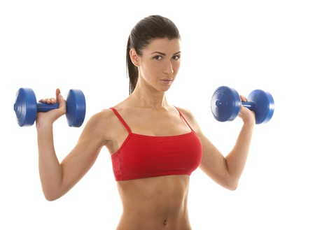 athletic brunette lifting weights on white isolated background Stock Photo - 16878814