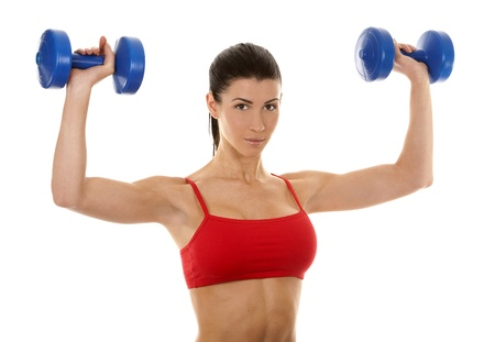 athletic brunette lifting weights on white isolated background Stock Photo - 16878813