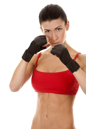 athletic brunette wearing boxing gloves on white isolated background Stock Photo - 16878867