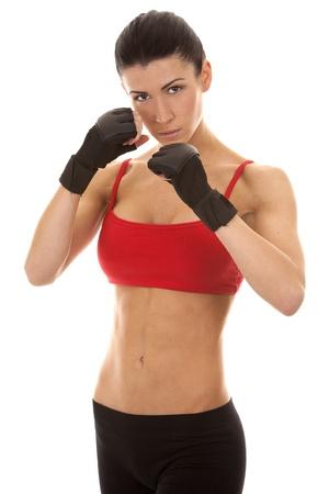 athletic brunette wearing boxing gloves on white isolated background Stock Photo - 16878862