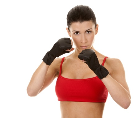 athletic brunette wearing boxing gloves on white isolated background Stock Photo - 16878816