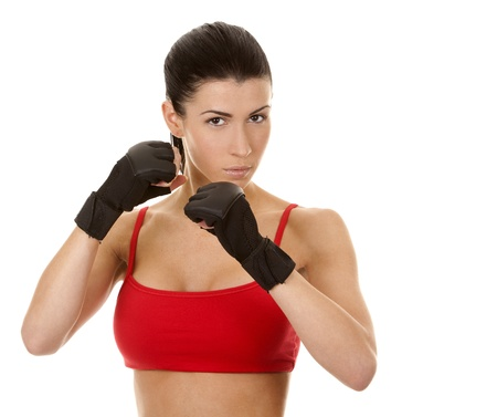athletic brunette wearing boxing gloves on white isolated background Stock Photo - 16878817