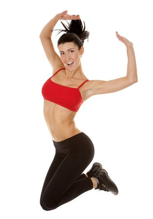 active brunette in red jumping on white isolated background Banque d'images