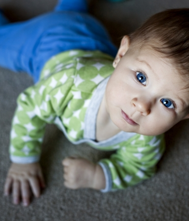 baby is playing on the carpet Stock Photo - 16878821